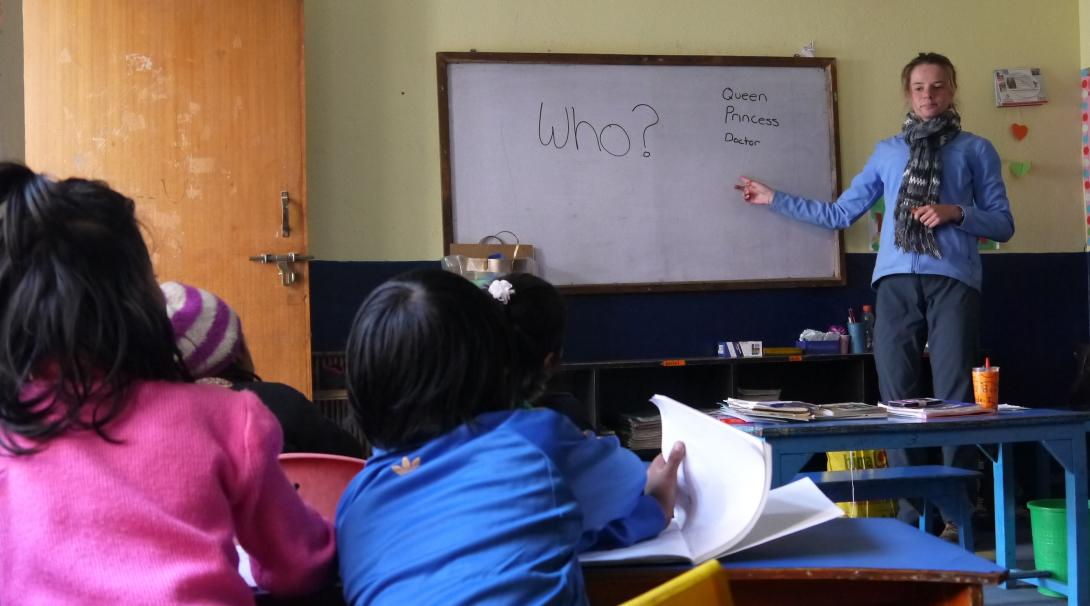 Projects Abroad volunteers teach children in Nepal to read, write, and count.